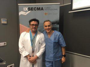 Dr. Fahandezh con Dr. Delgado organizador del curso.